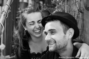 couple session marseille inner courtyard stairs laughing lovers bw amelie clements photography