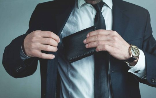 What are the benefits associated with the use of leather wallets?